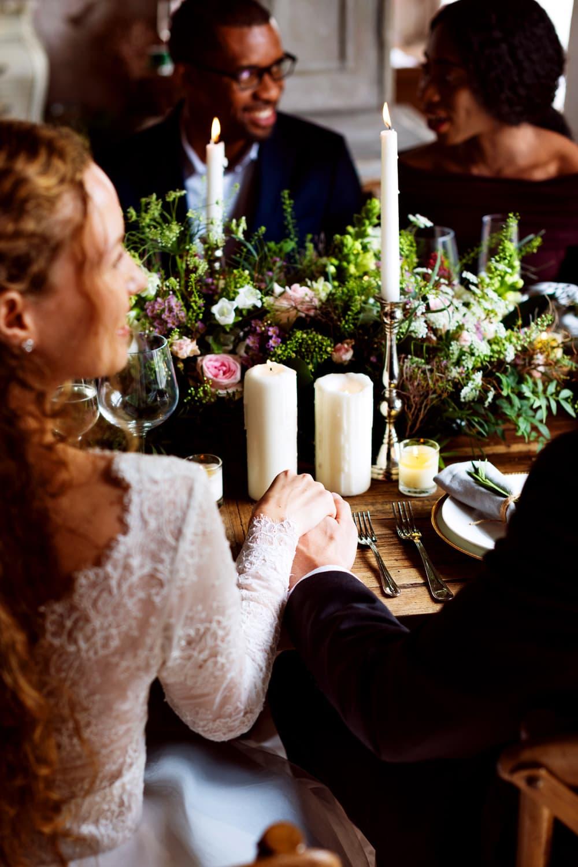 Happy wedding reception holding hands